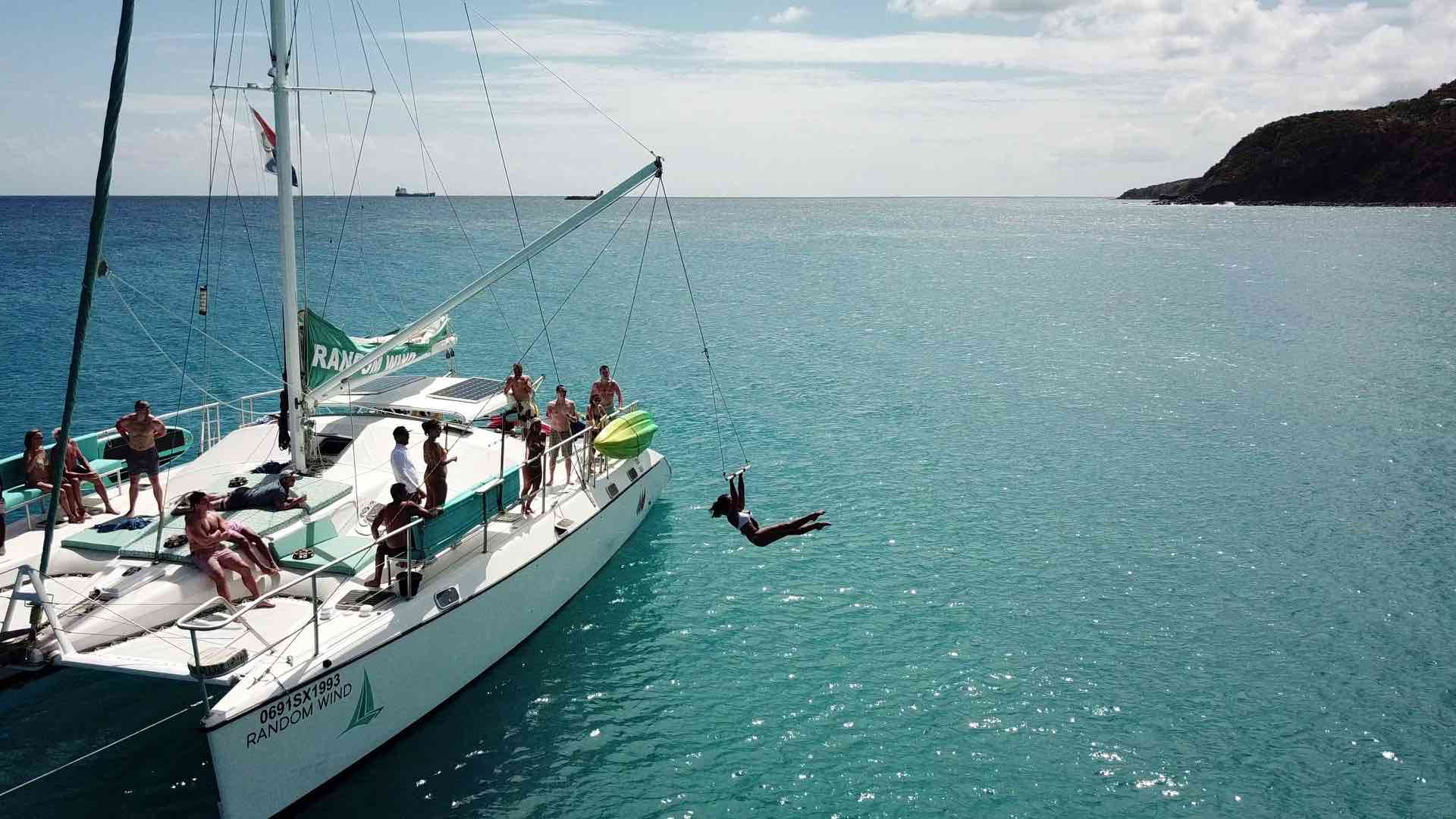 Random Wind Charters offer fun things to do in St Martin like sailing and jumping into the water off the boat using a swing