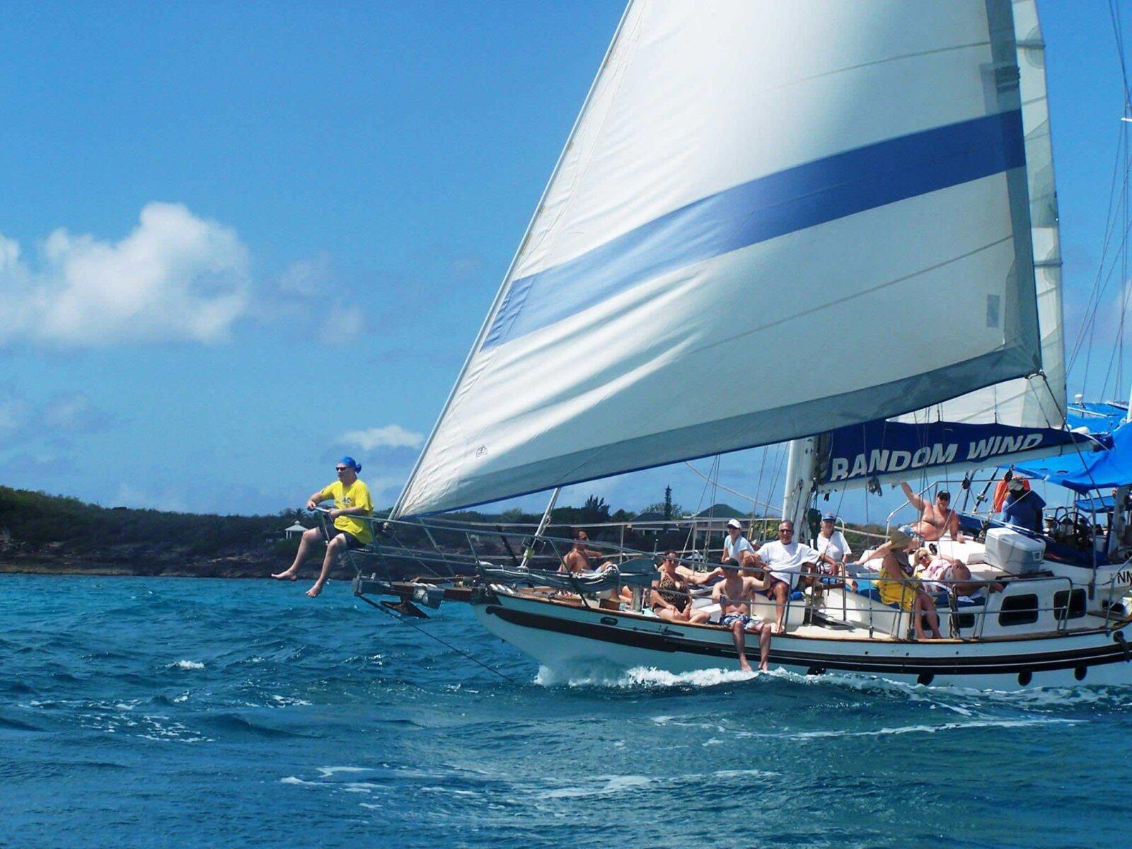 People aboard Random Wind Charters yacht under full sail
